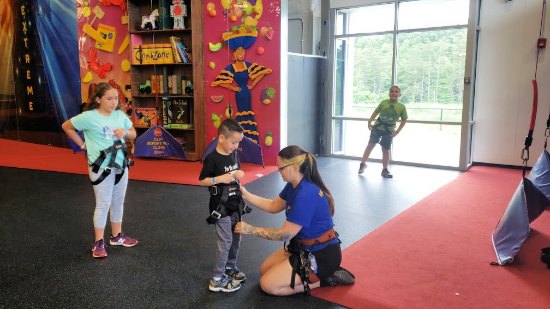 ClimbZone Employees Helping to Adjust Harness at ClimbZone White Marsh